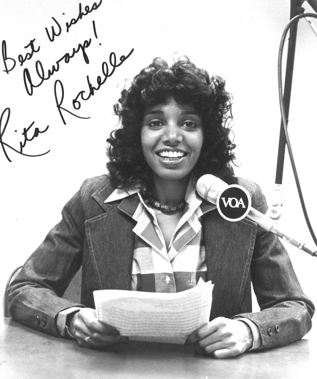 "Signed picture of Rita Rochelle in the VOA studio that reads ""Best Wishes Always! Rita Rochelle"""