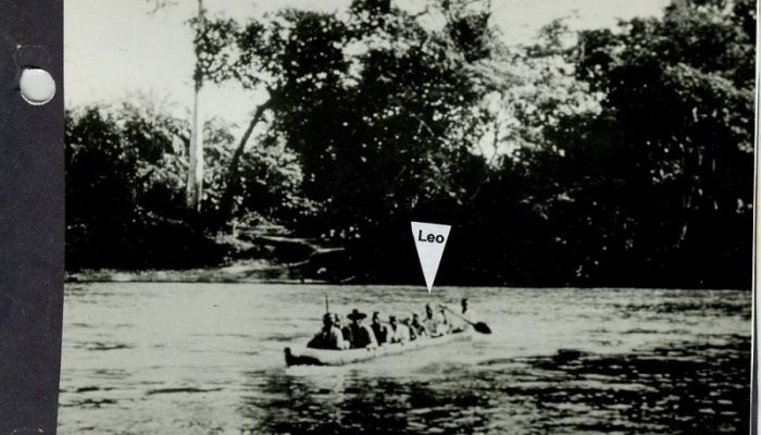 A canoe full of people in a river, with a label identifying Leo