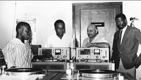 Leo and three radio broadcasters standing with equipment