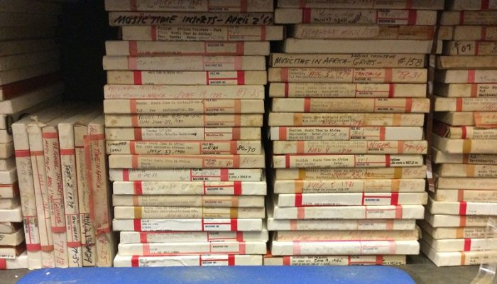 Many stacks of VOA tape boxes on a shelf